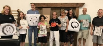 a fun group workshop painting sumi-e and calligraphy