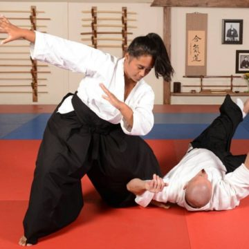 Woman Performs Aikido Koshinage Throw
