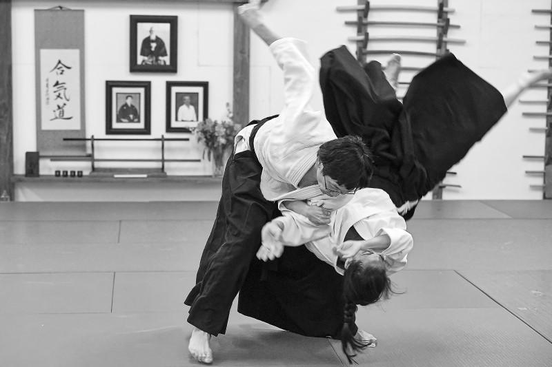 aikido students practice koshinage hip throw